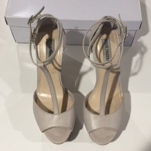 Nude platform heels with peep toes & T straps.